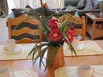 Couch,Furniture,Flower Arrangement,Vase,Dining Table