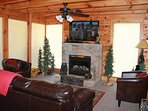 Enjoy the fireplace & large flat screen TV/DVD w/ independent satellite receiver