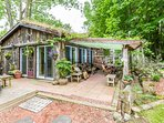 600 sq ft. self catering cottage. Viewing the forest, private patio and yard and the animals