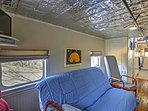 The railcar interior features a comfortable futon and plenty of modern comforts.