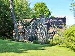 Lush foliage surrounds the beautiful home.