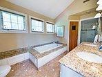 Draw a bubble bath in this en-suite bathroom.