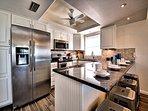 Renovated kitchen has granite counter tops.