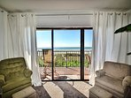 Living room has beautiful view of the beach.