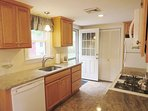Updated kitchen with a dishwasher. Access to the back patio from the door  to the right of the sink - 37 Jacqueline...