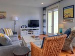Enjoy a Book or Watch TV on the Flat Screen TV in the Cozy Living Area