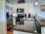 Fully Equipped Kitchen with Stainless Appliances and Exquisite Granite Countertops for Preparing Meals