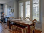 Spacious Farmhouse Dining Table for enjoying meals during your stay at Sundune #204