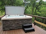 Extra large hot tub overlooking LIttle River