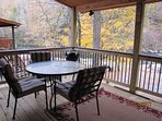 River Escape back deck with table  chairs  Hot Tub
