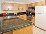 The new kitchen features granite counters and new appliances and cabinets