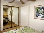 Bedroom closet with mirrored doors