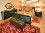 High end mattress and stylish furnishings in the queen bedroom