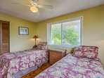 One of the bedrooms offers twin beds