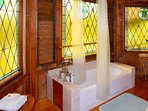 And what cool bathroom they are! Tropical stained glass windows