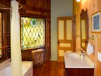 The south suite has a tub and hand held shower