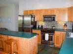 High end range, fridge, microwave and dishwasher in elegant stainless steel finish