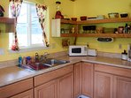 The kitchen is clean and tidy, with all the usual large and small appliances