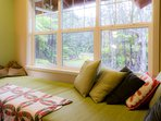 Relax on the window seat looking out to the fern forest