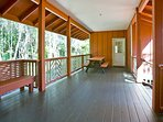 Covered lanai from main house has large picnic table and seating areas