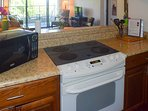 Electric stove-top, range and microwave, plus a host of small appliances are on hand