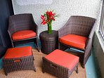 Two wicker chairs with ottomans round out the lanai furnishings