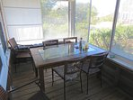 The porch has a dining table . . .