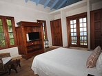 The upper level guest bedroom of the main house has a beautiful view