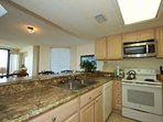 Well equipped kitchen has full size appliances, plenty of counter space, everything needed for meal preparation.