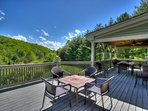Expansive back deck with seating a gas BBQ and beautiful views.