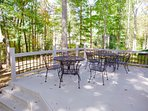 Back deck area overlooking the fire pit and koi-pond