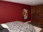 Bedroom 6 – queen bed (lower level)