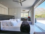 Main Bedroom opening up onto large deck with views of Table Mountain and Lions Head and the city
