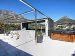 Large entertaining deck with views of Table Mountain, Lions Head, Signal Hill and the city.