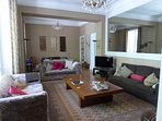 The spacious double sitting room with TV in English and French, and a large DVD library.