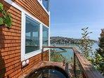 The cedar hot tub is off the master and, like everything else, overlooks the bay.