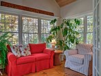 Curl up with a book in the sun room.