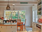 The kitchen area is light & welcoming due to the beautiful windows.