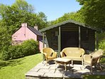 South facing summerhouse terrace and cane furniture, with sun parasol, seat cushions and BBQ