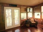 View of master bedroom- French doors to deck.