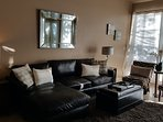 Living room with new beautiful leather furnishing, fireplace, large screen TV (there are 3 TV's)