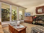 The living room features a 40' flat screen TV/DVD, wood burning fireplace, and spacious balcony.