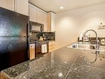 Plenty of room to dine in or entertain in this fully equipped kitchen with granite counters and all the essential...