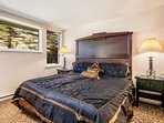Bedroom 2 is located on the entry level, it features a king bed and en suite bath.