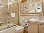 Bedroom 2 en suite bath with tub/shower combo and single vanity.