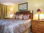 Comfortable king bed and en suite bath in the master bedroom.