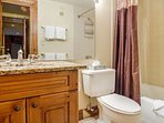 Master en suite bath with single vanity and tub/shower combo.