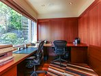 An office for two is attached to the master. It has partial views, printer and supplies.