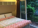 Bedroom with Terrace overlooking gardens. All rooms have air conditioning