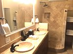Tropical Suite Bathroom all in Marble and features double sinks